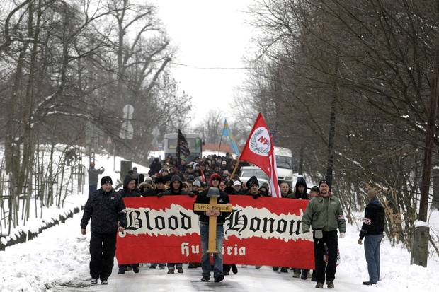 Hugarian activists of the neo-Nazi group, Blood and Honour, march in a rally in Budapest in February, 2013. Alberta has a group of the same name, which has caused concern with some communities.