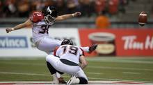 Calgary Stampeders' Rene Paredes, left, kicks a field goal as Bo Levi Mitchell holds during the first half of the CFL Western Final football game against the B.C. Lions in Vancouver, B.C., on Sunday November 18, 2012. (The Canadian Press)