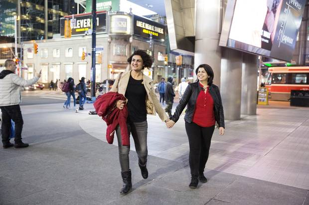 Samar Al Busiri, left, and her girlfriend Evan Murtadha, right, who escaped family censure and brutality in Iraq because of their sexual orientation, enjoy a night out on Friday, March 25, 2017.