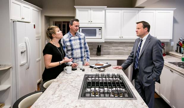 Mr. Shelestowsky advises clients in person, as he did recently with Mr. Roszkowski and Ms. Heathers seen here in the kitchen of their bed and breakfast. 'They want advice from a human. But they also want to know how AI might start affecting their investment decisions. It's starting to become part of the conversation,' Mr. Shelestowsky says.