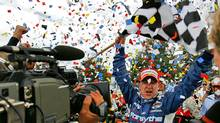 A.J. Allmendinger is showered with confetti after winning the Champ Car Grand Prix of Denver back in 2006. (EVAN SEMON/AP)