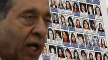 Photographs of missing women are displayed as commissioner Wally Oppal speaks at a public forum for the missing women's inquiry in Vancouver on Jan. 19, 2011. (DARRYL DYCK/THE CANADIAN PRESS)