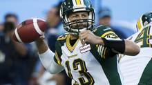 Edmonton Eskimos quarterback Mike Reilly throws the ball while playing against the Toronto Argonauts during first half CFL action in Toronto, on Sunday, August 18, 2013. (Nathan Denette/The Canadian Press)