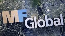 MF Global Holdings signage at its offices in midtown Manhattan, Nov. 1, 2011. MF Global's Canadian unit has about 50 employees, operating out of trading offices in Toronto and Montreal. (SHANNON STAPLETON/REUTERS)