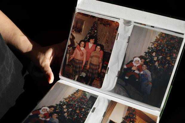 Merell Awad shows family photos from her childhood during Christmas at home in Syria.