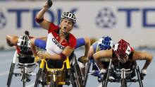 Canada's Diane Roy , foreground left, celebrates winning the Women's 800m Wheelchair final ahead of Japan's Wakako Tsuchida, right, at the World Athletics Championships in Daegu, South Korea, Sept. 3, 2011. Canada's objective in London is to finish top-eight in the overall gold-medal count. After finishing tied for third in 2000 and third in 2004, Canada slipped to seventh in 2008 with 19 gold. (The Canadian Press)