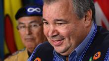 David Chartrand, president of the Manitoba Métis Federation, and, in the background, Clement Chartier, head of the Métis National Council, express their joy at the Supreme Court ruling in an Ottawa press conference. (Sean Kilpatrick/The Canadian Press)