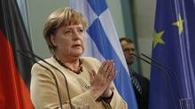German Chancellor Angela Merkel gestures during a news conference after talks with Greek Prime Minister Antonis Samaras at the Chancellery in Berlin on August 24, 2012. (THOMAS PETER/REUTERS)