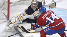 Buffalo Sabres goaltender Ryan Miller makes a save against Montreal Canadiens' Tomas Plekanec during third period NHL action in Montreal, Saturday, March 23, 2013. (CP)