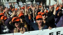 People chant slogans during a demonstration in Athens on October 20, 2011. (LOUISA GOULIAMAKI/AFP/Getty Images)