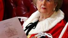 In this Nov. 15, 2006 file photo, former British Prime Minister Margaret Thatcher sits in the House of Lords awaiting the Queen's speech during the State Opening of Parliament in London, Wednesday, Nov. 15, 2006. (Adrian Dennis/AP)