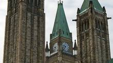 The Peace Tower sits between the towers of the Senate on Parliament Hill in January of 2011. (Sean Kilpatrick/THE CANADIAN PRESS)