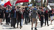 A few hundred demonstrators walk to a hotel Saturday, May 5, 2012 where the Quebec Liberal Party is meeting in Victoriaville, Quebec. (Jacques Boissinot/THE CANADIAN PRESS/Jacques Boissinot/THE CANADIAN PRESS)