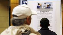 Job seeks line up at a jobs fair. (Jeff McIntosh For The Globe and Mail)