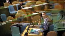 Iran's President Mahmoud Ahmadinejad addresses the United Nations General Assembly in New York on Sept. 22, 2011, as reflections in the glass of a viewing booth show many empty chairs in the chamber after delegates walked out. (Eric Thayer/Reuters/Eric Thayer/Reuters)