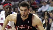 Toronto Raptors center Andrea Bargnani drives past Detroit Pistons center Ben Wallace during the first half of their NBA basketball game in Auburn Hills, Michigan April 12, 2010. (REBECCA COOK/Reuters)