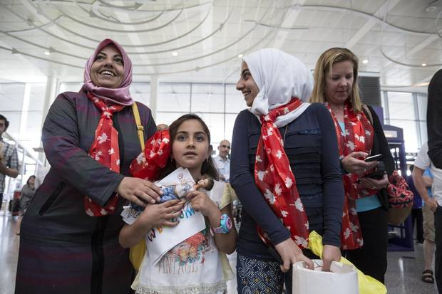 Aliye waits at Toronto's Pearson International with daughters Meram, 8, and Esra, 13, for the much-anticipated arrival of her sister Iman's family, who also have moved to Canada.