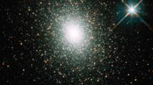 FILE PHOTO: This image released 17 September 2002 shows globular cluster G1, a large globular cluster, that harbors a hefty black hole, about 20,000 times more massive than our Sun. (NASA/AFP)
