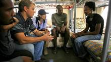 U.S. actor Matt Damon meets Sharon Ruzvid, 18, a Zimbabwean refugee who was raped whilst pregnant, during his visit to the South African border town of Musina in Zimbabwe Tuesday, March 3, 2009. (Jerome Delay/The Associated Press)
