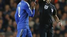 Chelsea's John Obi Mikel is shown a yellow card by referee Mark Clattenburg during their English Premier league soccer match against Manchester United at Stamford Bridge in London October 28, 2012. (EDDIE KEOGH/REUTERS)