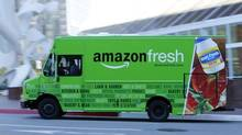 An Amazon delivery truck drives in down town Los Angeles, California May 13, 2014. Traditional retailers in Europe and North America are now ramping up their online food offer to compete with Amazon.com, which is expected to expand its sale of fresh produce beyond a few trial areas with the aim of complementing its non-food sales – and eating other retailers' lunch. (© Mike Blake / Reuters)