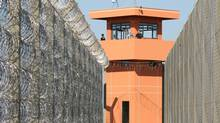 Policemen stand inside a federal penitentiary in Catanduvas in Brazil's southern state of Parana. (Jamil Bittar/Reuters)