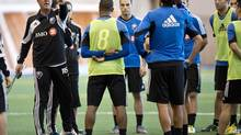 Montreal Impact head coach Marco Schallibaum talks to the players during the first day of training camp Montreal, Monday, January 21, 2013. (Paul Chiasson/THE CANADIAN PRESS)