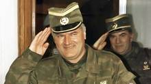 General Ratko Mladic salutes, followed by his senior aide General Milan Gvero Belgrade on March 26,1993. (Petar Kujundzic/Reuters/Petar Kujundzic/Reuters)