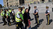 Police arrest a protester on Parliament Hill during a demonstration against the proposed Keystone XL pipeline on Sept. 26, 2011. (Sean Kilpatrick/THE CANADIAN PRESS)