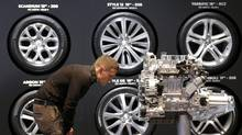 A visitor looks at an engine on media day at the Paris Mondial de l'Automobile. (CHRISTIAN HARTMANN/REUTERS)
