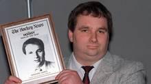 Former hockey coach Graham James accepts a Hockey News award in Toronto in this June 8, 1989, photo. (BILL BECKER/Canadian Press)