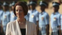 Australian Prime Minister Julia Gillard inspects a guard of honor on her arrival at the Indian Presidential palace for a ceremonial reception, in New Delhi, India, Wednesday, Oct. 17, 2012. (Manish Swarup/AP)