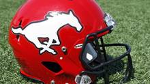 A Calgary Stampeders' helmet is seen in this file photo (Jeff McIntosh/The Canadian Press)