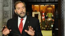 New Democratic Party MP Thomas Mulcair speaks to reporters in the foyer of the House of Commons on Parliament Hill in Ottawa on Sept. 27, 2011. (Sean Kilpatrick/THE CANADIAN PRESS)