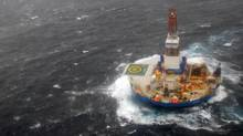 In this photo provided by the U.S. Coast Guard, the mobile drilling unit Kulluk is towed by the tugs Aiviq and Nanuq near Kodiak City, Alaska, on Dec. 30, 2012. (AP)