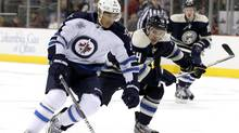 Winnipeg Jets' Evander Kane (L) fights for the puck with Columbus Blue Jackets' Grant Clitsome during the first period of their NHL hockey game in Columbus, Ohio November 12, 2011. (MATT SULLIVAN/REUTERS/MATT SULLIVAN/REUTERS)