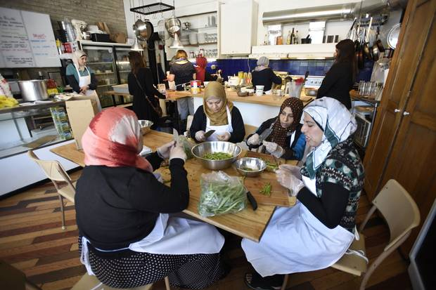 Members of the Syrian refugee community gather to prepare and cook traditional meals on June 9, 2016.
