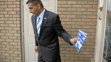 Parm Gill, the Conservative candidate for the Brampton-Springdale riding does some last minute canvassing as he looks to unseat incumbent, Liberal Ruby Dhalla. (Fred Lum/The Globe and Mail)