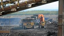 Heavy machinery operates in the pit at the Shell Albian Sands located in Alberta's oil sands north of Fort McMurray, Alta, Aug. 31, 2010. (Kevin Van Paassen/The Globe and Mail/Kevin Van Paassen/The Globe and Mail)