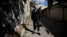 Author Anthony De Sa is photographed in the Little Portugal neighbourhood of Toronto on Sept. 17, 2013. (Moe Doiron/The Globe and Mail)