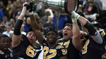 The Hamilton Tiger-Cats last hoisted the Grey Cup in 1999, when they knocked off the Calgary Stampeders in Vancouver. Only the Winnipeg Blue Bombers have suffered a longer drought. (RYAN REMIORZ/THE CANADIAN PRESS)