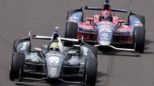 Tony Kanaan pumps his fist in front of Marco Andretti to celebrate after winning the Indianapolis 500 auto race at Indianapolis Motor Speedway in Indianapolis, Sunday, May 26, 2013. (AJ Mast/AP Photo)