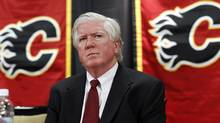 Newly named Calgary Flames president of hockey operations Brian Burke listens to a question during a news conference in Calgary, Thursday, Sept. 5, 2013. (The Canadian Press)