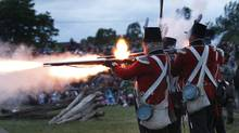 A volley of musket fire erupts from the the line of soldiers from the 1st Royal Scots Grenadiers during the Saturday evening battle re-enactment. Re-enactors from various regiments of the Crown Forces of Upper Canada participated in a two-day re-enactment of The Battle of Stoney Creek on June 1-June 3, 2012. (Peter Power/The Globe and Mail)