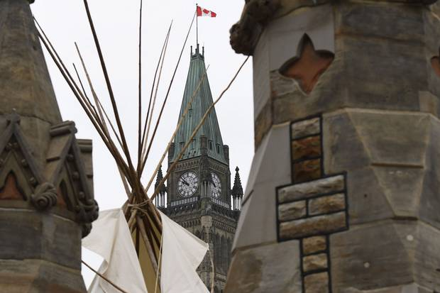 A large teepee, erected by Indigenous demonstrators to kick off a four-day Canada Day protest, stands in front of Parliament Hill in Ottawa on June 29, 2017.