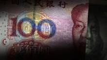 File photo of a 100 yuan banknote being placed next to a U.S. 100 dollar banknote in this picture illustration. (Petar Kujundzic/Reuters)
