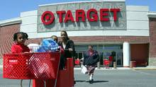 Shoppers emerge from a Target store in Boston (CHITOSE SUZUKI)