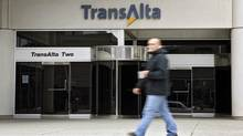 A pedestrian walks past the TransAlta building in downtown Calgary, Monday, Oct. 5, 2009. (Jeff McIntosh/The Canadian Press)