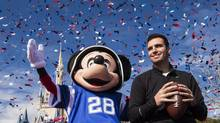 In this photo provided by Disney, Super Bowl MVP Joe Flacco rides with the character Mickey Mouse in a parade through the Magic Kingdom at Walt Disney World Resort on Monday, Feb. 4, 2013, in Lake Buena Vista, Fla. (Matt Stroshane/AP)