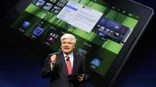 Mike Lazaridis, president and co-chief executive officer of Research in Motion, holds the Blackberry PlayBook (ROBERT GALBRAITH/REUTERS/ROBERT GALBRAITH/REUTERS)